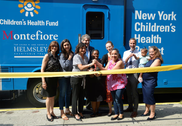 Children's Health Fund staff, patients, and supporters at the ribbon cutting ceremony for a new, state-of-the-art mobile medical clinic in New York City.