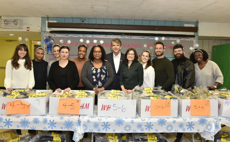 H&M donates coats and employees participate in coat give-away at a school.