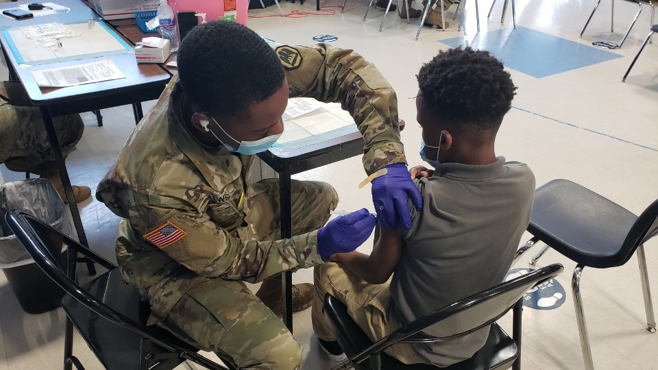 Deron, 12, receives a COVID-19 vaccine during an outreach event at a school, organized by our partner program in Baton Rouge, Louisiana.